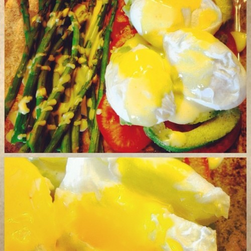 By far my FAVORITE breakfast to date! Poached eggs over tomatoes & avocado with steamed asparagus topped with paleo hollandaise sauce...OMG!